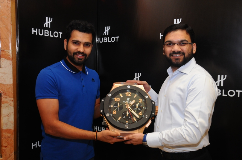 Cricketer Rohit Sharma (R) presents Mr.Sharjeel Khan (L), Director, Zimson the exclusive Hublot Clock